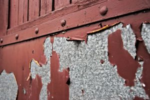 Rusty garage door with scraped paint